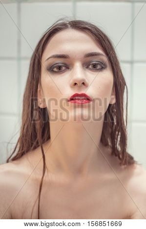 beautiful girl with freckles looking at camera, toned image
