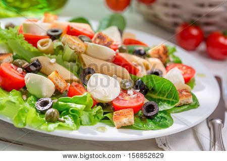 Enjoy Your Spring Salad On Old Wooden Table