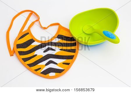 striped Bib, green bowl and spoon for baby