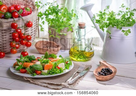 Homemade Salad With Salmon And Vegetables On Old Wooden Table