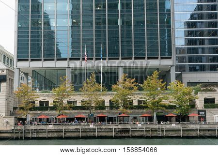 Chicago IL USA - September 25 2015: People are sitting in the cafe on the cost Chicago river.