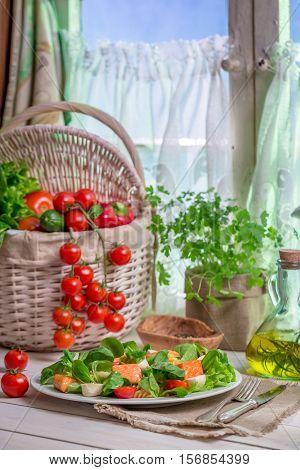 Spring Kitchen Full Of Fresh Vegetables On Old Wooden Table