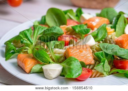 Closeup Of Salmon With Vegetables And Lettuce