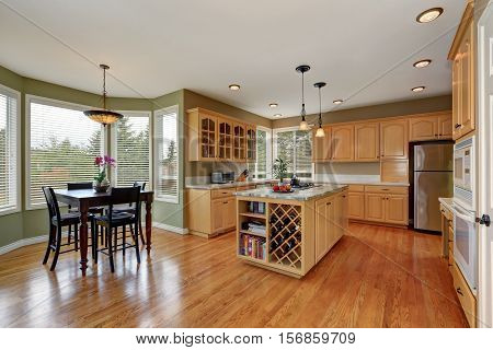 Maple Storage Combination And Large Island In The Kitchen Room