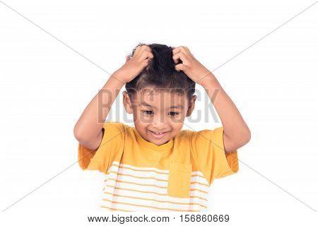 Cute childe asian little boy scratching head