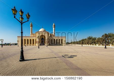 MANAMA, BAHRAIN - NOV 16, 2016: View of the beautiful Al Fateh Grand Mosque in Bahrain with the lamppost