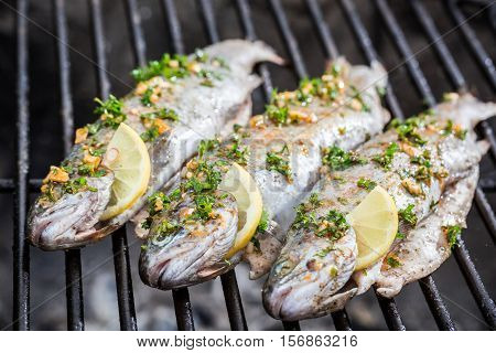 Grilled Fish With Lemon And Spices On Grill