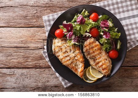 Roasted Chicken Breast With Mix Salad Of Chicory, Tomatoes And Lettuce Close-up. Horizontal Top View