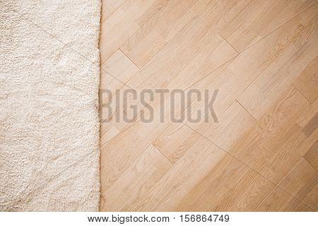 Laminate parquete floor. Light wooden texture. Beige soft carpet. Warm interior design poster