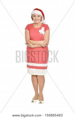 Full lenght portrait of smiling senior woman in Santa hat isolated on white background
