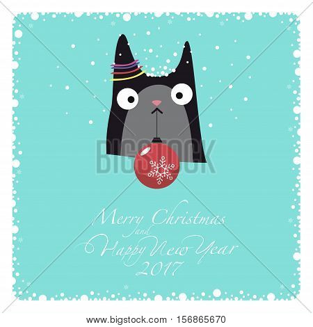 Greeting card. Two-tone cat holding a Christmas toy on a string. One ear decoration. From the bottom of the postcard the phrase merry christmas and happy new year and numbers: two, zero, one ,seven.