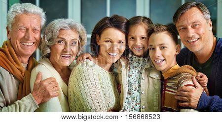 Portrait of big happy family looking at the camera