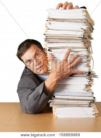 Portrait of an Unhappy Employee Behind a Stack of Documents