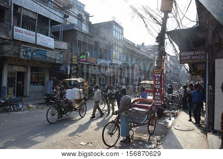 NEW DELHI, INDIA, FEBRUARY 02, 2016 - Unidentified  indian people and rickshaws in the busy and old area of Chandni Chowk in the old part of the city