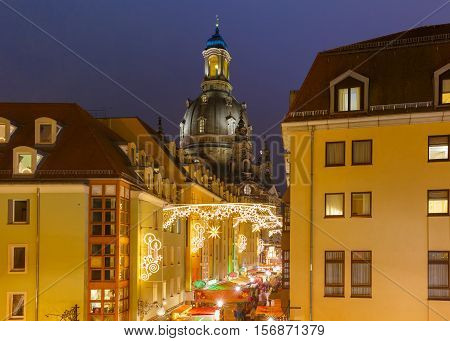 Lutheran church of Our Lady aka Frauenkirche with decorated and illuminated Christmas street at night in Dresden, Saxony, Germany