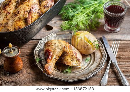 Roasted Chicken And Jacket Potato Served With Wine