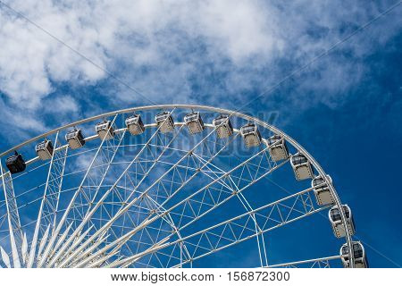 Ferris Wheel with blue sky in sunny day summer time Background Concepts
