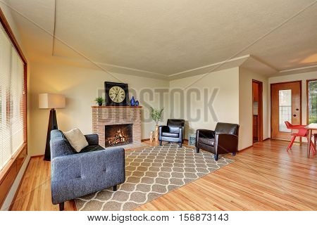 Classic Living Room Interior Brick Trimmed Fireplace.