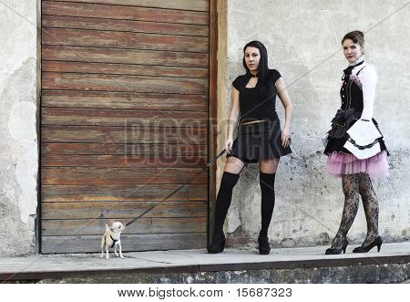 modern punk fashion, portrait of two models posing dressed In vintage clothes