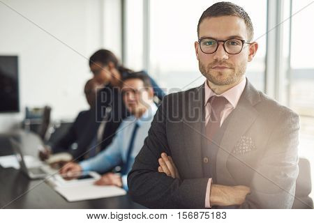 Handsome Bearded Professional With Folded Arms