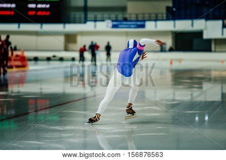 explosive start athlete speed skater to sprint on ice rink. competitions in speed skating