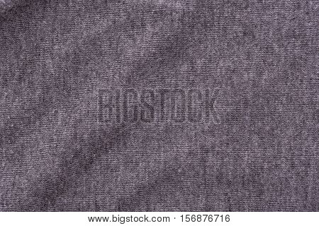 Close up of wrinkled dark grey bedsheet texture background.