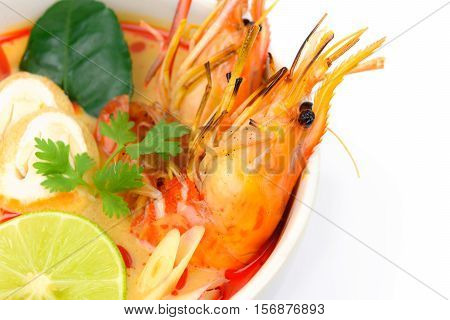 Closeup Tom Yum Soup or River Prawn Spicy Sour Soup (Tom Yum Goong) isolated on white background Thai local food