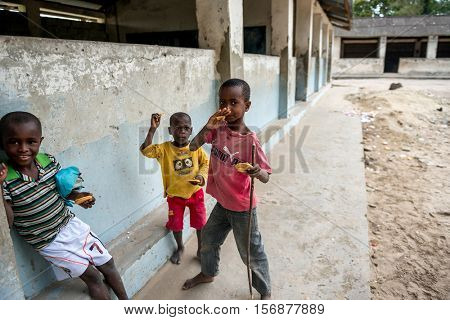 ZANZIBAR, TANZANIYA- JULY 15: cheerful african children near a village school on July 15, 2016 in Zanzibar