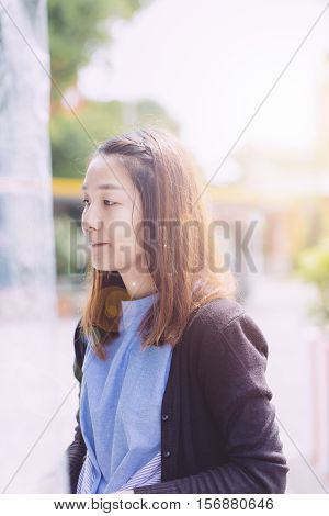 Young Hipster Woman, Chinese Women In Thiking Someting At The Prak With Fresh Air.