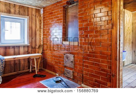 interior a rustic bath with stove on summer
