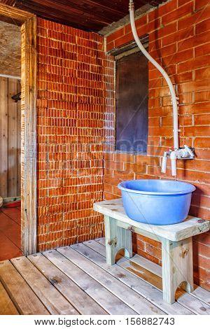 interior a rustic bath with blue tub