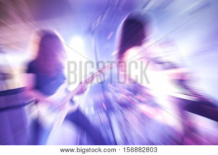 motion blur of guitarists in a rock band
