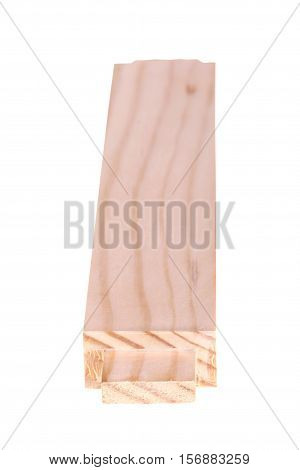 Pine board with a woodworking tenon at one end and a shallow depth of field isolated against a white background