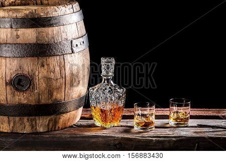 Two Glasses Of Scotch And Old Wooden Barrel