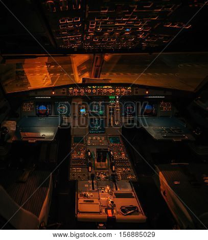 Yerevan Armenia - October 14 2016: Vimavia Airbus A319 aircraft illuminated interior without pilots at night