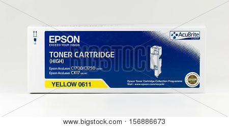 WREXHAM UK - OCTOBER 27 2016: Close up of a yellow high capacity Epson Acubrite toner cartridge for the AcuLaser C1700/1750 series and CX17 series printers on a white background.