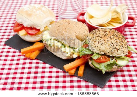 Healthy lunch A healthy child's snack lunch of sandwiches cobs or rolls and fruit