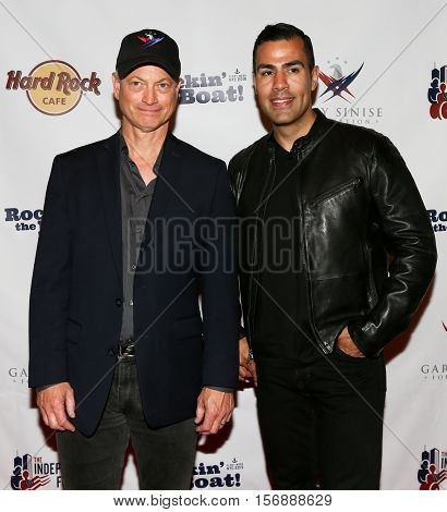 NEW YORK - MAY 21: Actor Gary Sinise (L) and J. W. Cortes attend a benefit concert at the Hard Rock Cafe on May 21, 2015 in New York City.