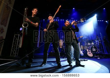 NEW YORK - MAY 21: Actor Gary Sinise (C) performs onstage with the Lt. Dan Band at a benefit concert at the Hard Rock Cafe on May 21, 2015 in New York City.