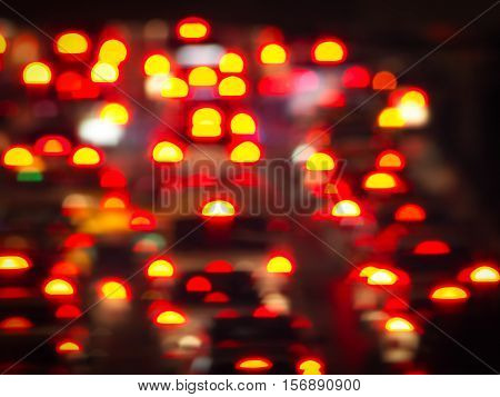 Photo technique image/ Abstract colorful blur de focused of yellow and red  Tail lights of cars on the road background, Night lights art concept
