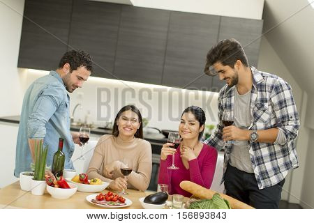 Young People Sitting By The Table