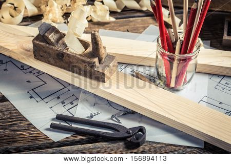 Drawing Workshop And Vintage Carpentry Workbench On Old Wooden Table