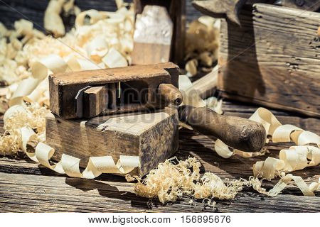 Planer On A Piece Of Wood And Sawdust