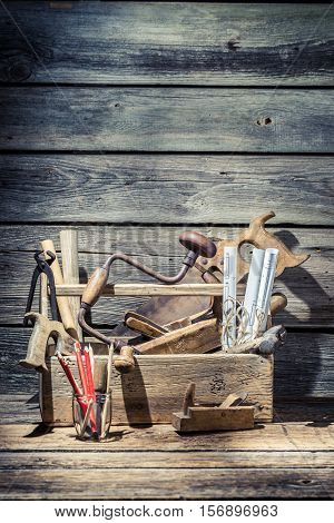 Vintage Carpenter Tools In Wooden Toolbox On Old Wooden Table