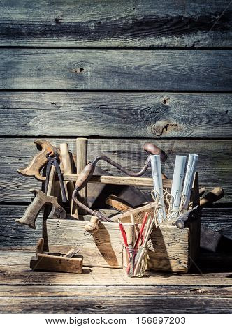 Carpenter Working Tools In A Toolbox On Old Wooden Table