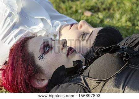CAGLIARI, ITALY - May 29, 2016: Sunday at La Grande Jatte VIII Ed. At the Public Gardens - Sardinia - portrait of beautiful girls in costumes steampunk