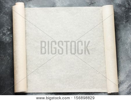 Open roll of baking parchment paper for menu or recipes text top view