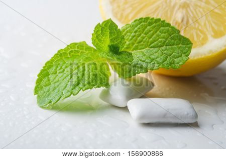 Fresh green mint leaf  with gums background. fresh breath
