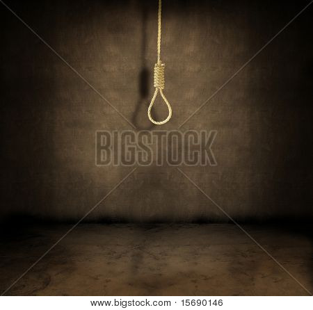 A noose hanging in a dark grungy room