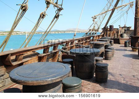 The deck of a pirate ship. Fragments of a pirate ship on a background of blue sky.